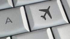 Et tastatur, hvor en af tasterne er en flyvemaskine.