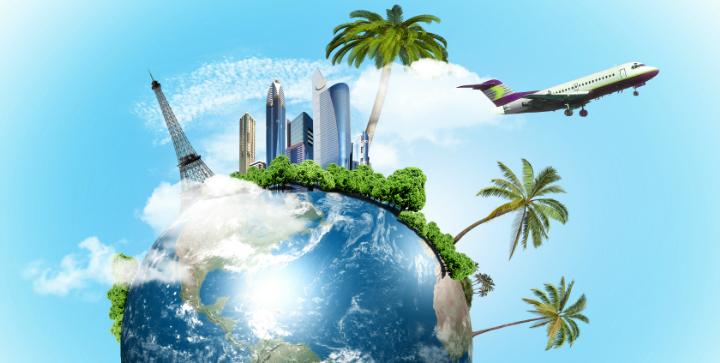 En globus med bygninger, palmer og en flyver.