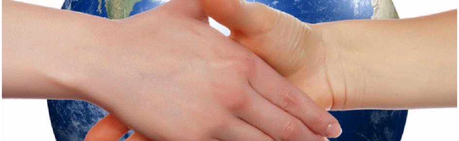 En globus og et håndtryk.